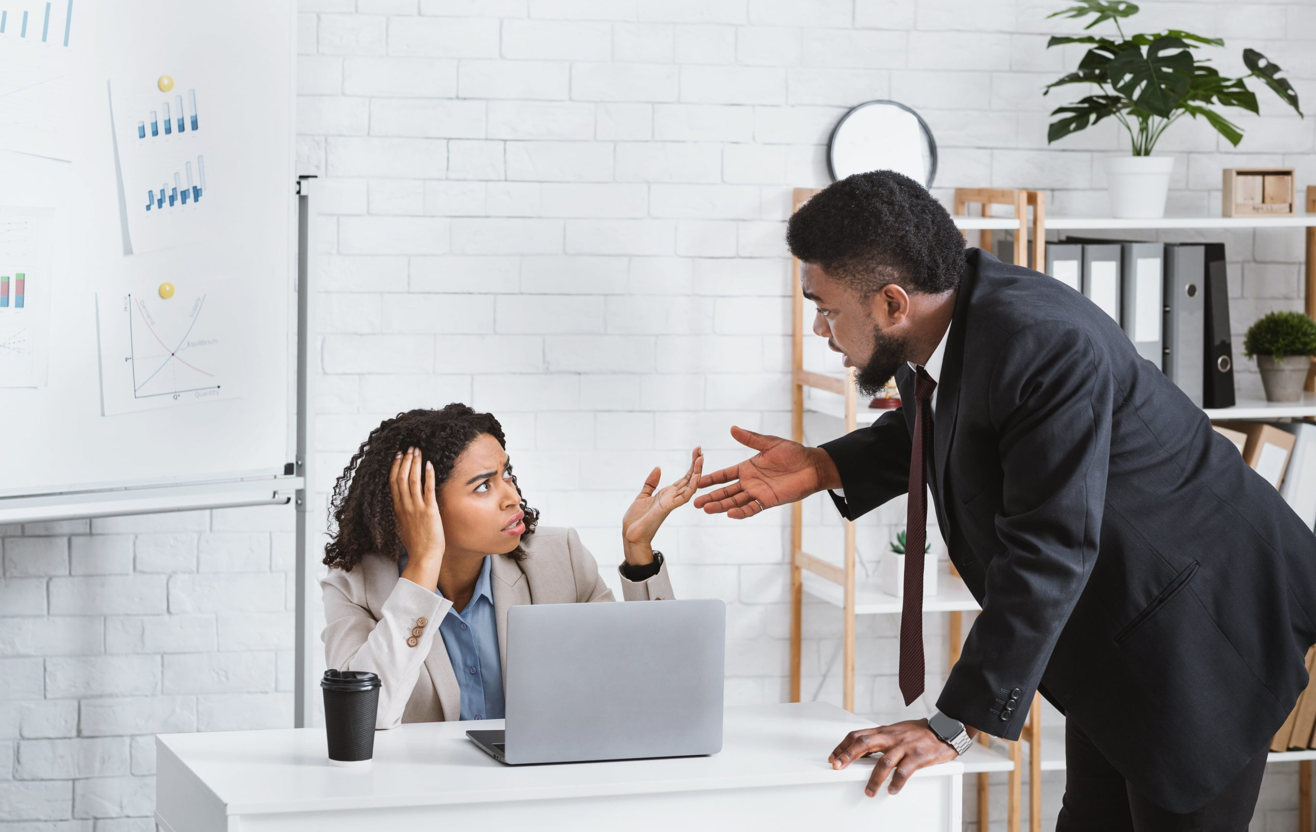 A man harasses a female colleague at her desk. This form of workplace discrimination is considered unfair discrimination, and unless your human resources department intervenes, could result in the female colleague filing a civil lawsuit against your company. Protect your organisation with business legal insurance.